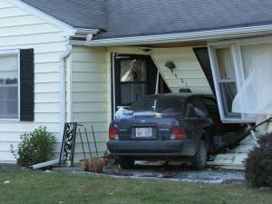 car into house